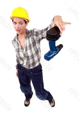 craftswoman throwing away her drill