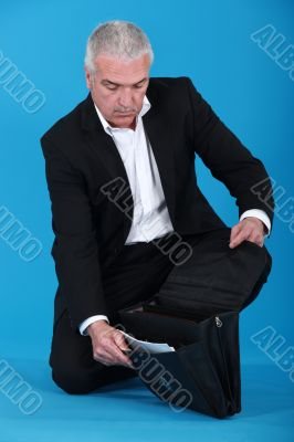Businessman opening his briefcase