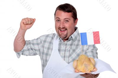 Man in a white apron celebrating French poultry