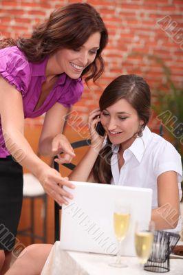 portrait of two businesswomen at restaurant