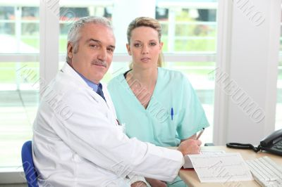Doctor with his assistant