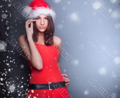 Portrait of beautiful young christmas woman posing.