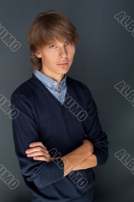 Portrait of a business man against grey background. Studio shot.