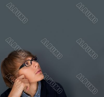 Image of young man thinking of his plans. Lots of copyspace.