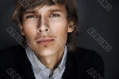 Portrait of young esquire man with smart and wise look.