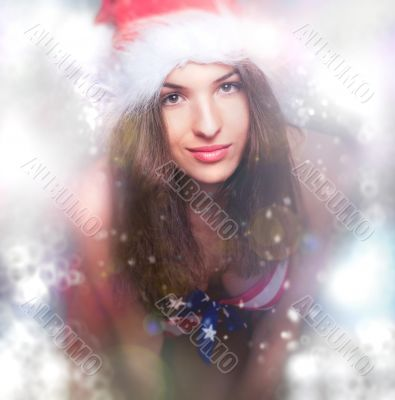 20-25 years old beautiful woman in christmas hat and swimsuit.