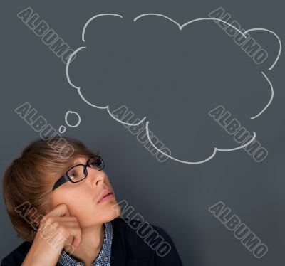 Image of young man thinking of his plans. Lots of copyspace inside graphic cloud for your text.