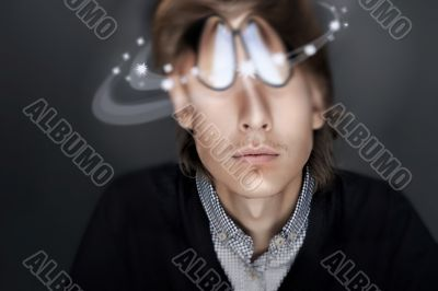 Young Business man against gray background. Distorted head and c