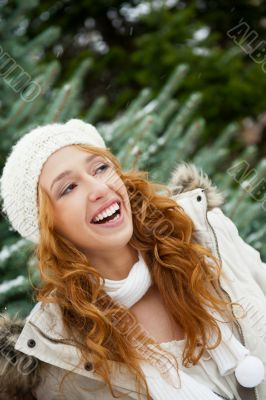 Portrait of young pretty woman in winter park
