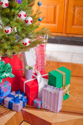 Christmas Tree and Christmas gift boxes in the interior
