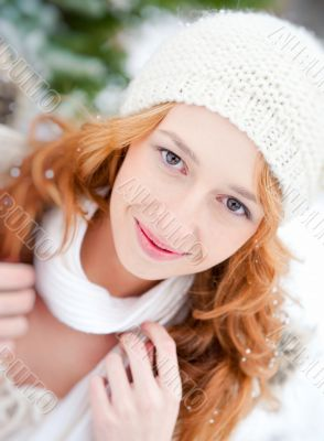 Portrait of beautiful young red hair woman outdoors in winter lo