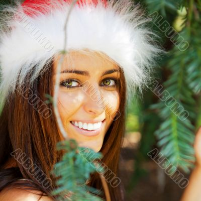 Portrait of a sexy young female smiling in a park and looking at