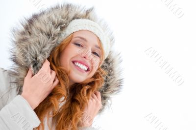 Young pretty woman enjoying herself at winter park. Laughing and