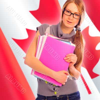 Portrait of pretty young woman holding book in her arms. Canadia