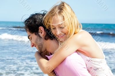 Couple in love - Hispanic man having his caucasian woman piggyba