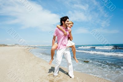 Couple in love - Hispanic man having his caucasian woman piggyba