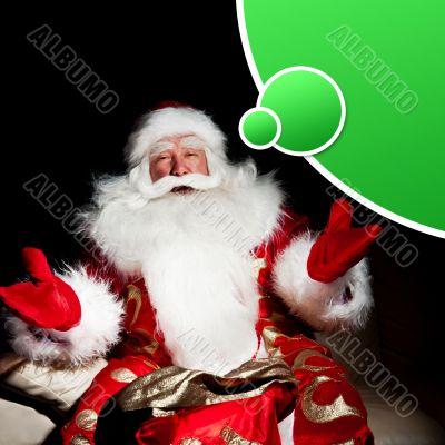Santa sitting with a sack indoor at dark night room