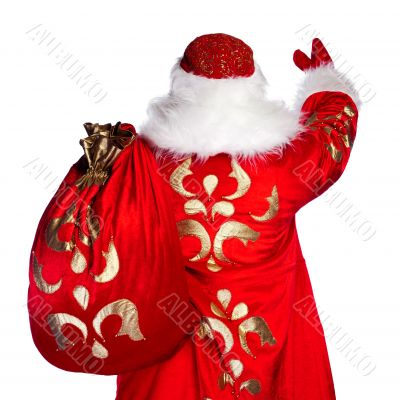 Santa Claus standing up on white background with his bag full of
