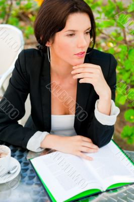 Portrait of a young attractive business woman sitting at outdoor