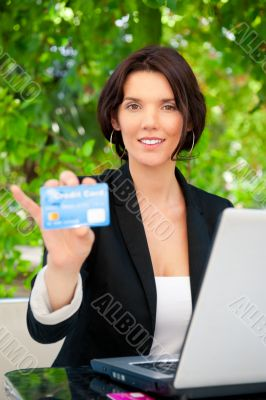 Business woman making payments online using laptop and credit ca