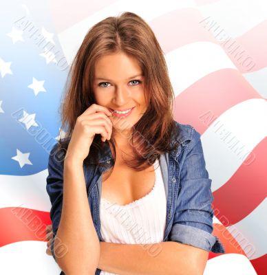 Portrait of a pretty young woman ôïôøòûå an American flag , smil