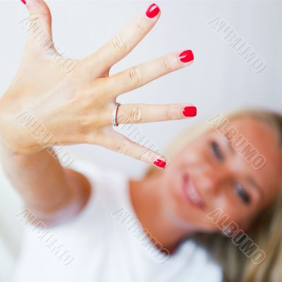 Happy young woman showing her proposal ring from her boyfriend.
