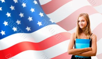 Portrait of pretty young woman holding book in her arms. USA Fla
