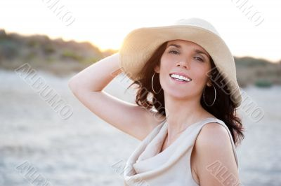 Summer portrait of beautiful carefree woman wearing hat. Vacatio