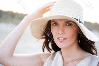 Summer portrait of beautiful woman wearing hat. Vacation at warm