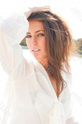 Portrait of beautiful hispanic woman posing and dancing outdoors