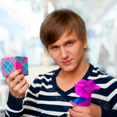 Portrait of young man inside shopping mall standing relaxed and