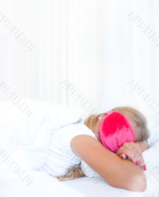 Closeup portrait of a cute young woman sleeping on the bed weari