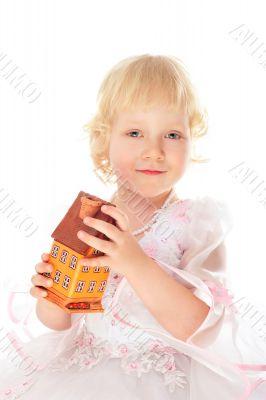 Closeup portrait of little caucasian girl holding house building