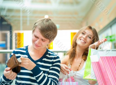 Woman can`t stop shopping at mall, making her man or boyfriend s