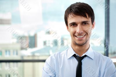 Portrait of young relaxed business man