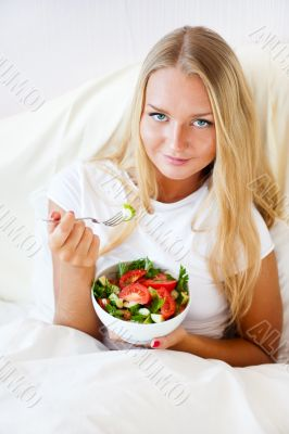 Closeup portrait of pretty caucasian woman having a healthy diet