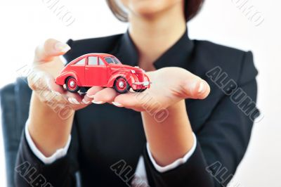 Portrait of a cute young girl planning to buy a new car against