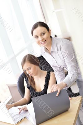 Portrait of two women reviewing data.