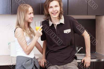 Playful young couple in their kitchen.