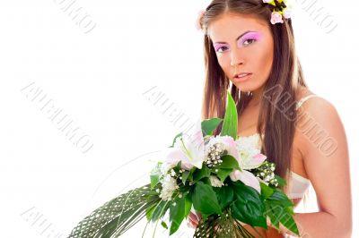 Closeup portrait of beautiful young woman wearing veil and weddi