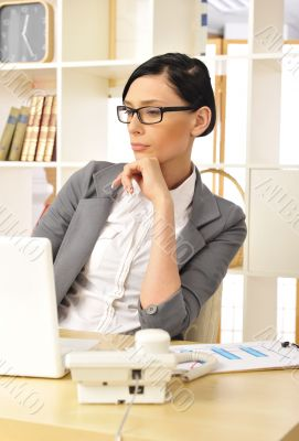 Portrait of a beautiful young businesswoman working.