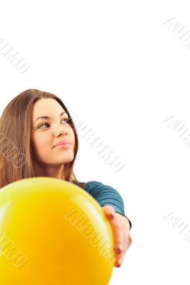 Young woman working out with a ball isolated on a white backgrou