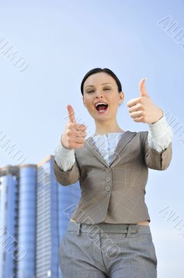 Portrait of a beautiful young businesswoman celebrating.