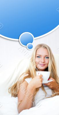 Smiling woman drinking a coffee lying on a bed at home or hotel.