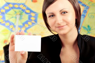 Closeup portrait of young pretty woman holding business card