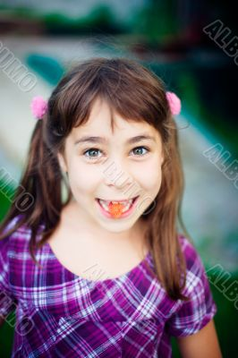 Artistic lifestyle photo of cute little girl outdoor at summer p