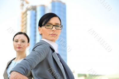 Portrait of a beautiful business woman with a female colleague