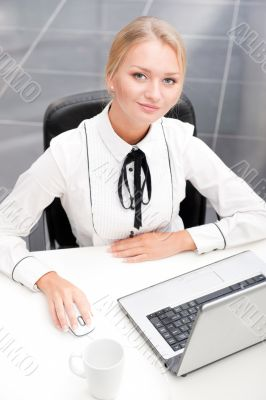 Beautiful business woman thinking about something while working