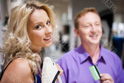 Young attractive happy couple shopping at mall.
