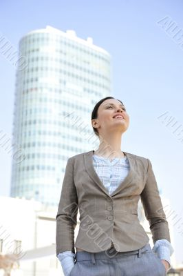 Portrait of a beautiful young businesswoman outside.